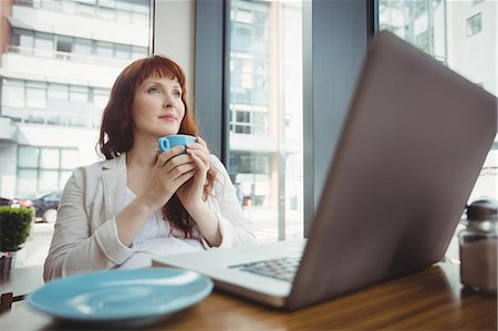 simsearch:6109-08700445,k - Pregnant businesswoman having coffee in office cafeteria Stock Photo - Premium Royalty-Free, Code: 6109-08929293