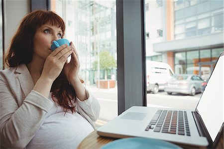 simsearch:6109-08700445,k - Pregnant businesswoman having coffee in office cafeteria Stock Photo - Premium Royalty-Free, Code: 6109-08929295