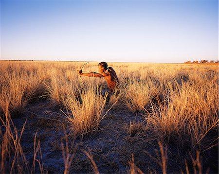 Bushmen Hunting in Grassy Field Namibia, Africa Stock Photo - Premium Royalty-Free, Code: 6110-08697975