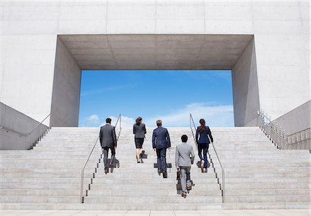 Business people ascending modern stairs Stock Photo - Premium Royalty-Free, Code: 6113-06497771