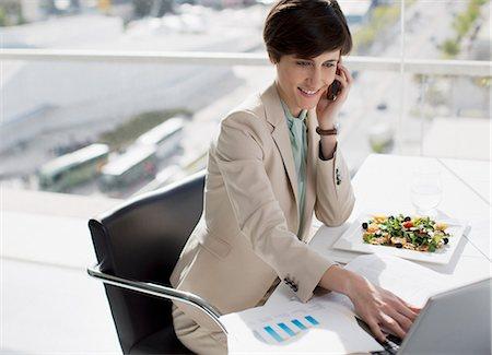 short hair - Businesswoman multitasking at desk Stock Photo - Premium Royalty-Free, Code: 6113-06497864
