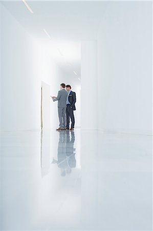 floor - Businessmen with digital tablet in corridor Stock Photo - Premium Royalty-Free, Code: 6113-06497893