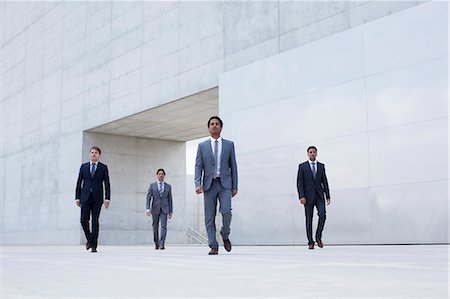 four - Businessmen leaving modern cultural center Stock Photo - Premium Royalty-Free, Code: 6113-06497813