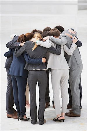 Business people in huddle Stock Photo - Premium Royalty-Free, Code: 6113-06497818