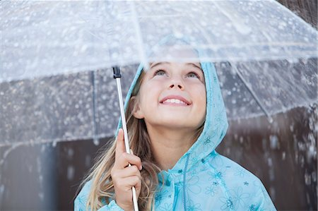 people with umbrellas in the rain - Close up of smiling girl under umbrella in downpour Stock Photo - Premium Royalty-Free, Code: 6113-06498070