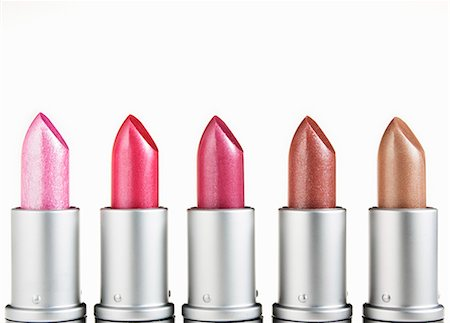 Close up of multicolor lipsticks in a row Stock Photo - Premium Royalty-Free, Code: 6113-06498021