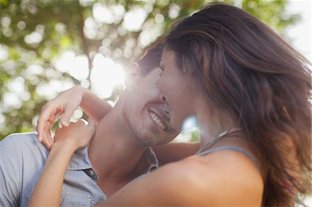 Close up of happy couple hugging Stock Photo - Premium Royalty-Free, Code: 6113-06498460