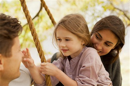 swing (sports) - Close up of family on swing Stock Photo - Premium Royalty-Free, Code: 6113-06498556