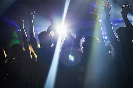Spotlight over crowd dancing on dance floor Stock Photo - Premium Royalty-Free, Code: 6113-06498593