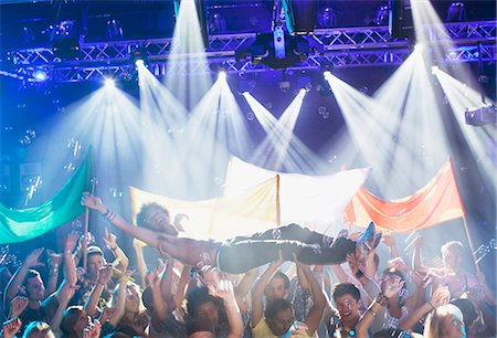 Man crowd surfing at concert Stock Photo - Premium Royalty-Free, Code: 6113-06498592