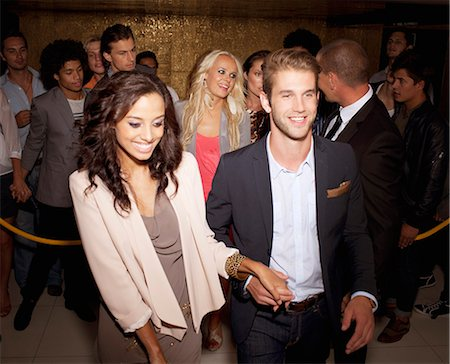 exterior bar - Couple granted access at nightclub Stock Photo - Premium Royalty-Free, Code: 6113-06498598