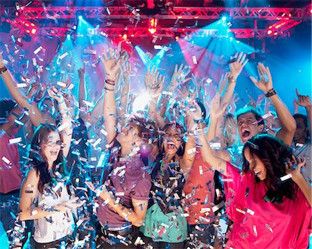 Confetti falling over enthusiastic crowd on dance floor of nightclub Stock Photo - Premium Royalty-Free, Code: 6113-06498599