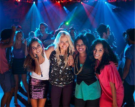 Portrait of smiling women on dance floor at nightclub Stock Photo - Premium Royalty-Free, Code: 6113-06498647