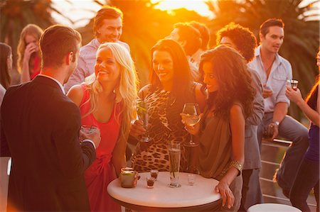 exterior bar - Smiling friends drinking cocktails on sunny balcony Stock Photo - Premium Royalty-Free, Code: 6113-06498648