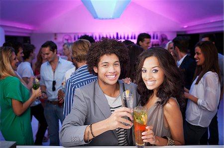 Portrait of smiling couple at bar of nightclub Stock Photo - Premium Royalty-Free, Code: 6113-06498649