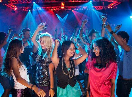 Smiling friends dancing on dance floor of nightclub Stock Photo - Premium Royalty-Free, Code: 6113-06498650