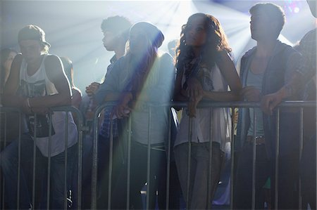 Crowd leaning on railing at concert Stock Photo - Premium Royalty-Free, Code: 6113-06498656