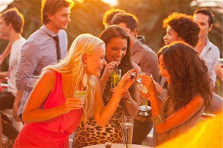 exterior bar - Smiling women drinking cocktails on sunny balcony Stock Photo - Premium Royalty-Free, Code: 6113-06498673