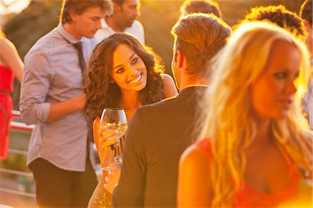 exterior bar - Smiling woman with wine glass talking to man on sunny balcony Stock Photo - Premium Royalty-Free, Code: 6113-06498687