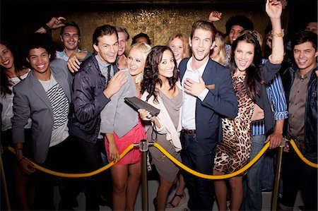 Portrait of enthusiastic crowd waiting in queue outside nightclub Stock Photo - Premium Royalty-Free, Code: 6113-06498691