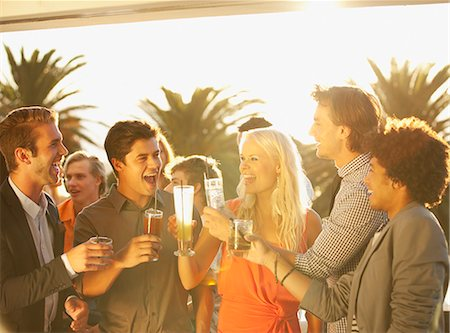 exterior bar - Friends toasting cocktails on sunny balcony Stock Photo - Premium Royalty-Free, Code: 6113-06498608