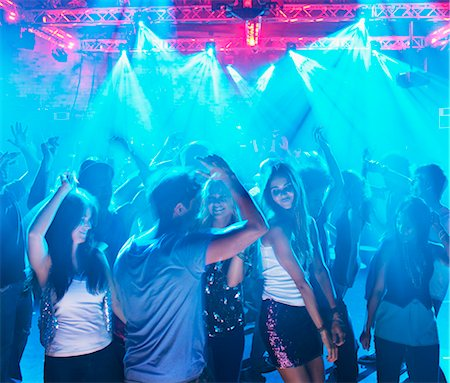 People dancing on dance floor of nightclub Stock Photo - Premium Royalty-Free, Code: 6113-06498612
