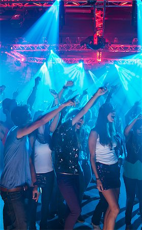 Crowd cheering with arms raised at concert Stock Photo - Premium Royalty-Free, Code: 6113-06498627