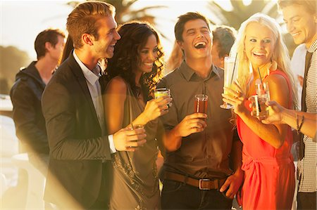 exterior bar - Laughing friends drinking cocktails on sunny balcony Stock Photo - Premium Royalty-Free, Code: 6113-06498633