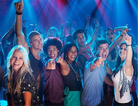 Portrait of enthusiastic crowd on dance floor of nightclub Stock Photo - Premium Royalty-Free, Code: 6113-06498637