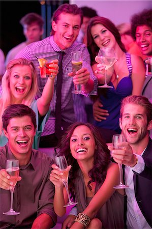 Portrait of smiling friends drinking cocktails in nightclub Stock Photo - Premium Royalty-Free, Code: 6113-06498636