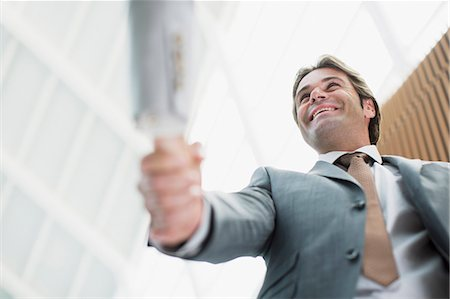 Smiling businessman shaking hands with businesswoman Stock Photo - Premium Royalty-Free, Code: 6113-06498759