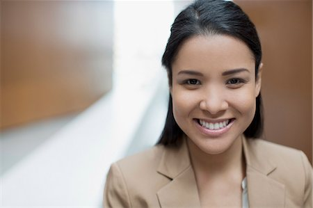 filipina - Close up portrait of confident businesswoman Stock Photo - Premium Royalty-Free, Code: 6113-06498857