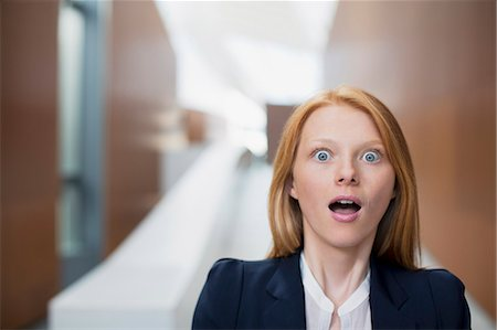 surprised - Portrait of shocked businesswoman Stock Photo - Premium Royalty-Free, Code: 6113-06498864