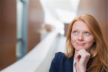 Portrait of pensive businesswoman looking up Stock Photo - Premium Royalty-Free, Code: 6113-06498888