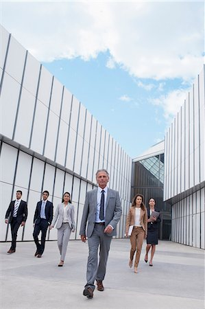 filipino ethnicity - Confident business people walking outside building Stock Photo - Premium Royalty-Free, Code: 6113-06498819