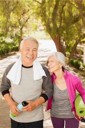 Older couple walking together outdoors Stock Photo - Premium Royalty-Free, Code: 6113-06499023