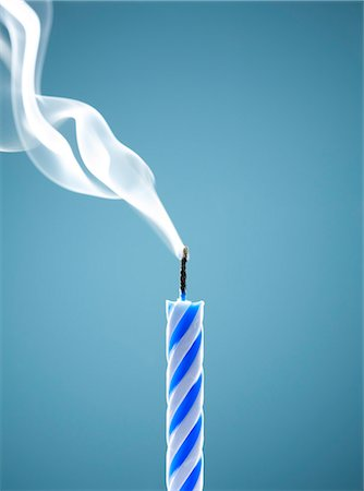 Close up of extinguished birthday candle Stock Photo - Premium Royalty-Free, Code: 6113-06499144