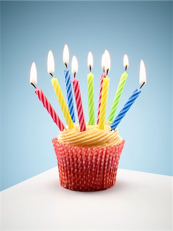 Close up of cupcake with lit birthday candles Stock Photo - Premium Royalty-Free, Code: 6113-06499145