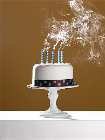 smoke - Extinguished birthday candles on birthday cake Stock Photo - Premium Royalty-Free, Code: 6113-06499146