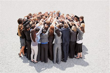 Crowd of business people in huddle Stock Photo - Premium Royalty-Free, Code: 6113-06499156