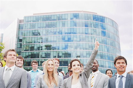 Crowd of smiling business people in front of building Stock Photo - Premium Royalty-Free, Code: 6113-06499159