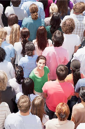Portrait of smiling woman among crowd Stock Photo - Premium Royalty-Free, Code: 6113-06499175