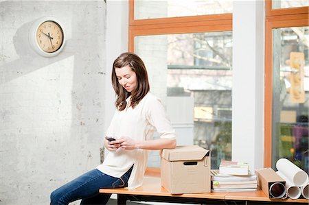 entry field - Businesswoman using cell phone in office Stock Photo - Premium Royalty-Free, Code: 6113-06625485