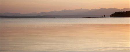 Sunset sky reflected in rural lake Stock Photo - Premium Royalty-Free, Code: 6113-06625497