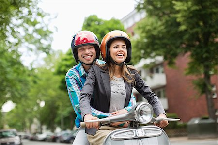 recreation - Couple riding scooter together on city street Stock Photo - Premium Royalty-Free, Code: 6113-06625576