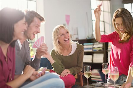 Friends playing card games in living room Stock Photo - Premium Royalty-Free, Code: 6113-06625644