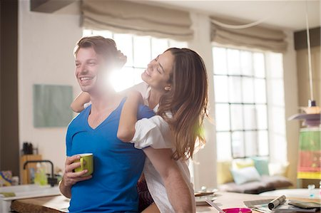 domestic life - Smiling couple hugging in kitchen Stock Photo - Premium Royalty-Free, Code: 6113-06625608