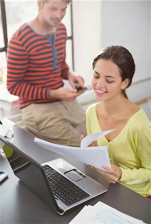 reviewing - Couple working together at desk Stock Photo - Premium Royalty-Free, Code: 6113-06625616
