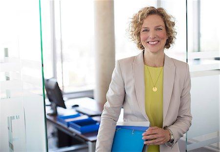 portrait smile caucasian one - Businesswoman smiling in office Stock Photo - Premium Royalty-Free, Code: 6113-06625761