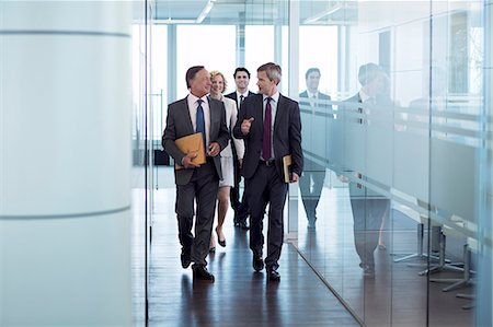 Businesspeople walking in hallway Stock Photo - Premium Royalty-Free, Code: 6113-06625764
